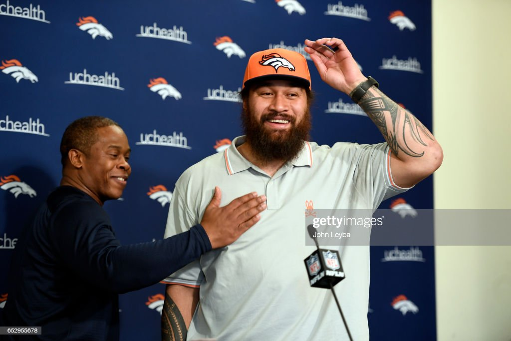 Denver Broncos head coach Vance Joseph gives a pat on the chest to Denver Broncos nose tackle Domata Peko on March 13, 2017 in Denver, Colorado at Dove Valley. Peko addressed the media during a press conference.