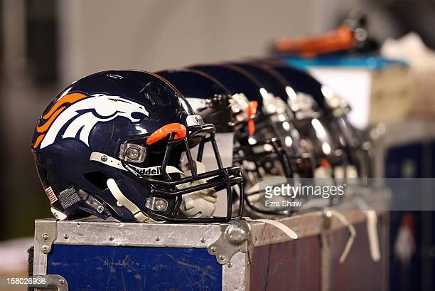 Denver Broncos helmets sit on the bench during their game against the Oakland Raiders at Oco Coliseum on December 6 2012 in Oakland California