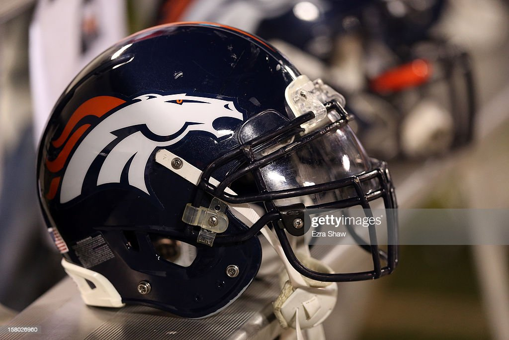 Denver Broncos helmets sit on the bench during their game against the Oakland Raiders at O.co Coliseum on December 6, 2012 in Oakland, California.
