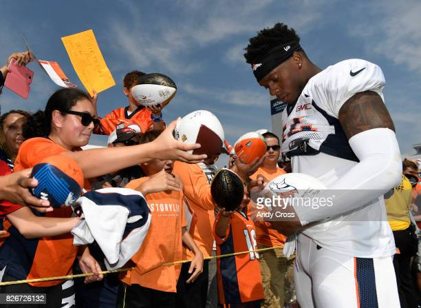 Denver Broncos inside linebacker Brandon Marshall signs autographs after scrimmage at Dove Valley August 05 2017