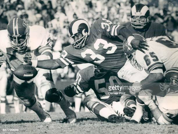 Denver Broncos It's Safe to Say that Denver Linemen had this Situation Well in Hand While it appears that Denver's Alzado is about to pounce on this...