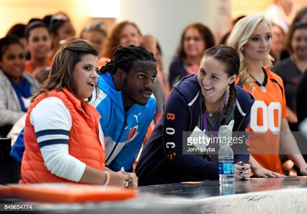 Denver Broncos Jamaal Charles hudles with his team as they compete against Aqib Talib and his team during a game of Family Feud Showdown at Childrens...