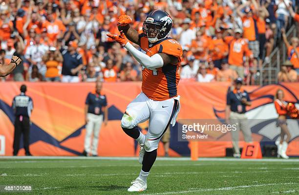 Denver Broncos linebacker Brandon Marshall celebrates a sack in the first quarter against the Baltimore Ravens at Sports Authority Field at Mile High...