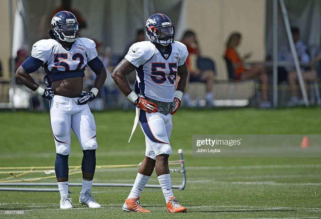 Denver Broncos linebacker Jerrell Harris (52) and Denver Broncos outside linebacker <a gi-track='captionPersonalityLinkClicked' href=/galleries/search?phrase=Lerentee+McCray&family=editorial&specificpeople=7418300 ng-click='$event.stopPropagation()'>Lerentee McCray</a> (55) look on during day 11 of the Denver Broncos 2014 training camp August 4, 2014 at Dove Valley.