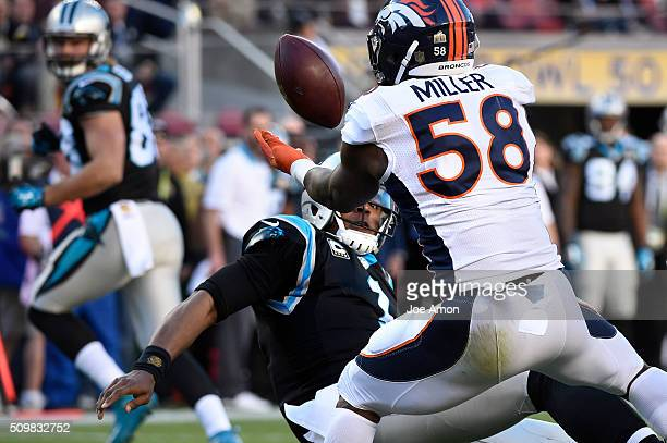 Denver Broncos linebacker Von Miller strips the ball from Carolina Panthers quarterback Cam Newton The fumble will recovered for a touchdown in Super...