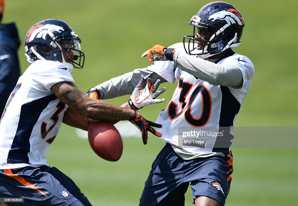 Denver Broncos <a gi-track='captionPersonalityLinkClicked' href=/galleries/search?phrase=Lorenzo+Doss&family=editorial&specificpeople=9753957 ng-click='$event.stopPropagation()'>Lorenzo Doss</a> (37) works on drills with B.J. Lowery (30) during OTA's May 31, 2016 at UCHealth Training Facility, Dove Valley.