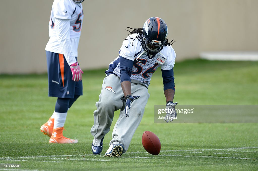 Denver Broncos middle linebacker <a gi-track='captionPersonalityLinkClicked' href=/galleries/search?phrase=Nate+Irving&family=editorial&specificpeople=4753462 ng-click='$event.stopPropagation()'>Nate Irving</a> (56) chases after a loose ball in drills during practice October 16, 2014 at Dove Valley.