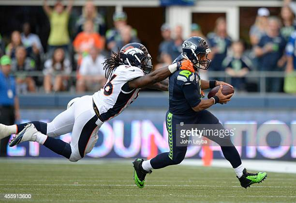 Denver Broncos middle linebacker Nate Irving dives after Seattle Seahawks quarterback Russell Wilson as he scrambles out of the pocket during...