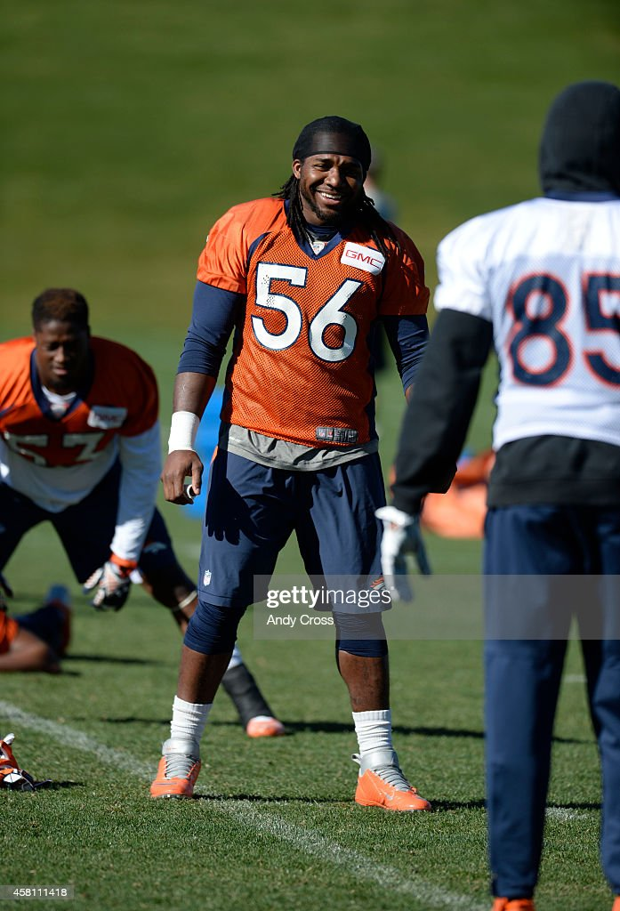 Denver Broncos middle linebacker <a gi-track='captionPersonalityLinkClicked' href=/galleries/search?phrase=Nate+Irving&family=editorial&specificpeople=4753462 ng-click='$event.stopPropagation()'>Nate Irving</a> #56 has a laugh with teammate tight end <a gi-track='captionPersonalityLinkClicked' href=/galleries/search?phrase=Virgil+Green&family=editorial&specificpeople=7250502 ng-click='$event.stopPropagation()'>Virgil Green</a> #85 during stretching at Dove Valley Thursday morning, October 30, 2014.