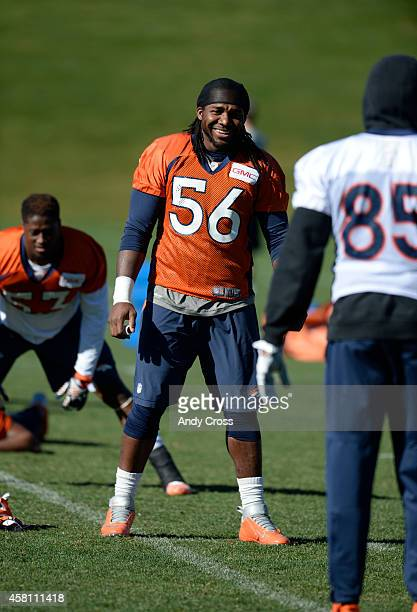 Denver Broncos middle linebacker Nate Irving has a laugh with teammate tight end Virgil Green during stretching at Dove Valley Thursday morning...