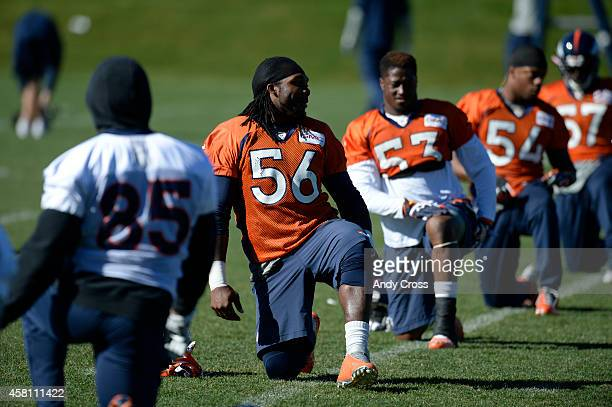 Denver Broncos middle linebacker Nate Irving second from left along with teammates stretch during practice at Dove Valley Thursday morning October 30...
