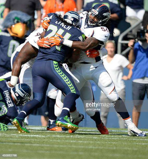 Denver Broncos middle linebacker Nate Irving wraps up Seattle Seahawks running back Marshawn Lynch during the first quarter September 21 2014 at...