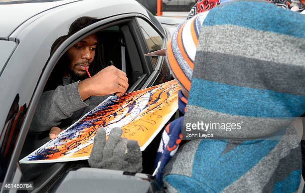 Denver Broncos Nate Irving signs autographs for fans at Dove Valley Broncos players left the facility after packing up their lockers January 12 2015...