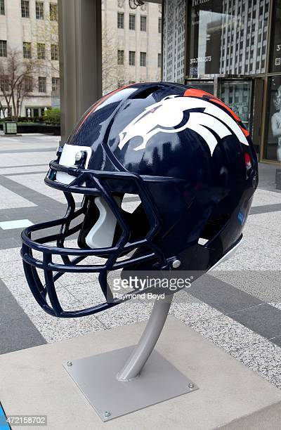 Denver Broncos NFL football helmet is on display in Pioneer Court to commemorate the NFL Draft 2015 in Chicago on April 30 2015 in Chicago Illinois