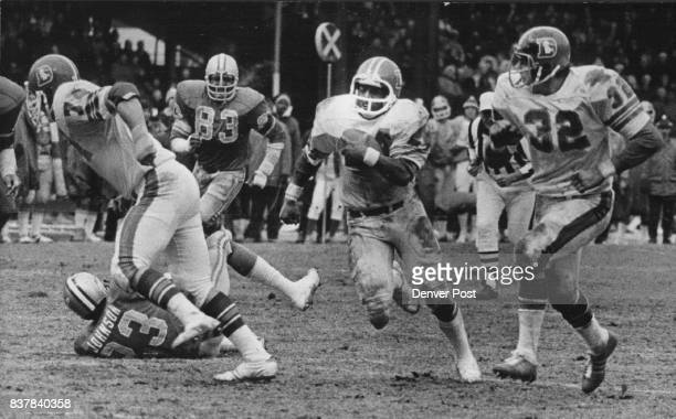 Denver Broncos Off and Running Beyond 1000 Yards Otis Armstrong breaks clear and races 31 yards ***** of Mike Current and Jon Keyworth early in third...