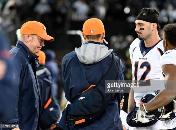 Denver Broncos offensive coordinator Bill Musgrave and Denver Broncos quarterback Paxton Lynch stand on the sideline stunned as time runs out on...