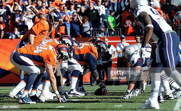 Denver Broncos offensive line at line of scrimmage against the New England Patriots in the second quarter at Sports Authority Field at Mile High