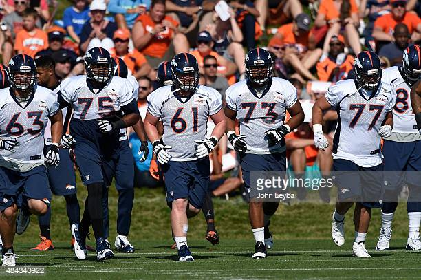 Denver Broncos offensive line during training camp August 17 2015 at Broncos headquarters