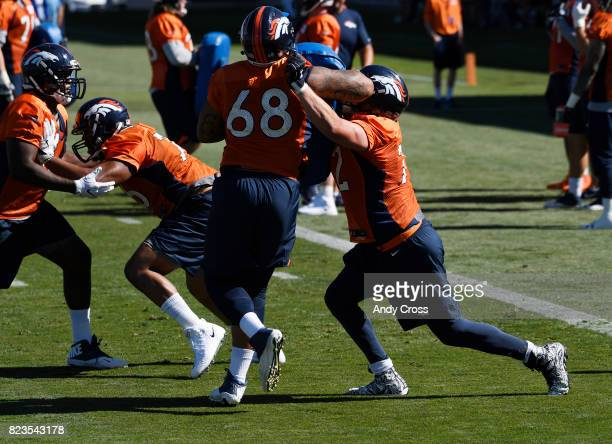 Denver Broncos offensive tackle Elijah Wilkinson left and Denver Broncos offensive tackle Garett Bolles on the first day of training camp at Dove...