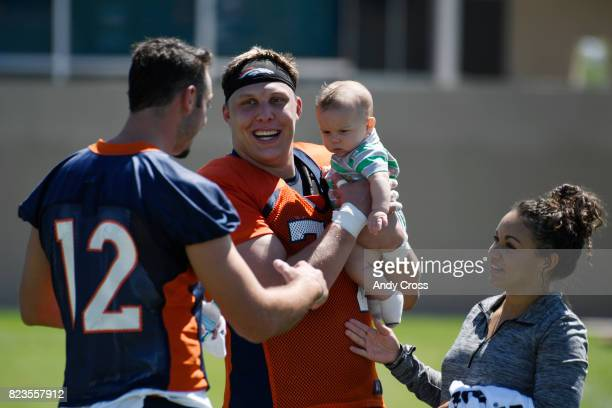Denver Broncos offensive tackle Garett Bolles and his wife Natalie introduce their son Kingston to Denver Broncos quarterback Paxton Lynch after the...