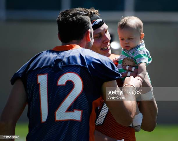 Denver Broncos offensive tackle Garett Bolles introduces his son Kingston to Denver Broncos quarterback Paxton Lynch after the first day of training...