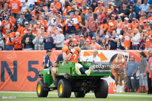 Denver Broncos offensive tackle Garett Bolles leaves the field on a cart after being injured during a game between the Denver Broncos and the Dallas...