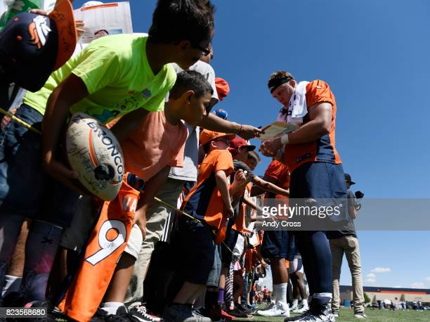 Denver Broncos offensive tackle Garett Bolles signs autographs for fans after the first day of training camp at Dove Valley July 26 2017