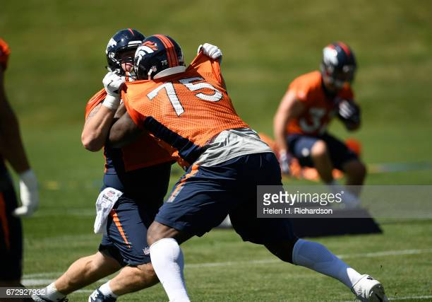 Denver Broncos offensive tackle Menelik Watson #75 during a voluntary veteran minicamp practice practice at Dove Valley on April 25 2017 in Englewood...