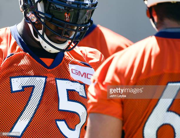 Denver Broncos offensive tackle Menelik Watson looks on during drills at mandatory mini camp on June 14 2017 in Englewood Colorado at Dove Valley
