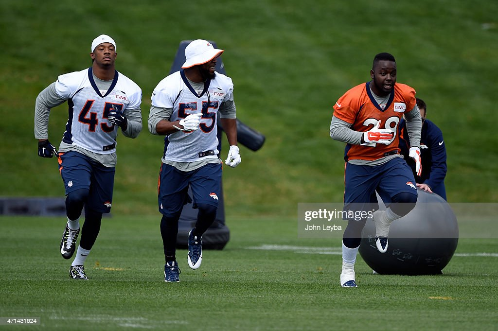 Denver Broncos outside linebacker Danny Mason, Denver Broncos outside linebacker <a gi-track='captionPersonalityLinkClicked' href=/galleries/search?phrase=Lerentee+McCray&family=editorial&specificpeople=7418300 ng-click='$event.stopPropagation()'>Lerentee McCray</a> (55) and Denver Broncos running back <a gi-track='captionPersonalityLinkClicked' href=/galleries/search?phrase=Montee+Ball&family=editorial&specificpeople=6475135 ng-click='$event.stopPropagation()'>Montee Ball</a> (28) run through drills during the teams mini camp April 28, 2015 at Dove Valley.