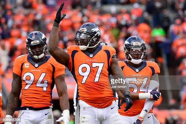 Denver Broncos outside linebacker DeMarcus Ware defensive end Malik Jackson and inside linebacker Brandon Marshall waiting on the line in the second...