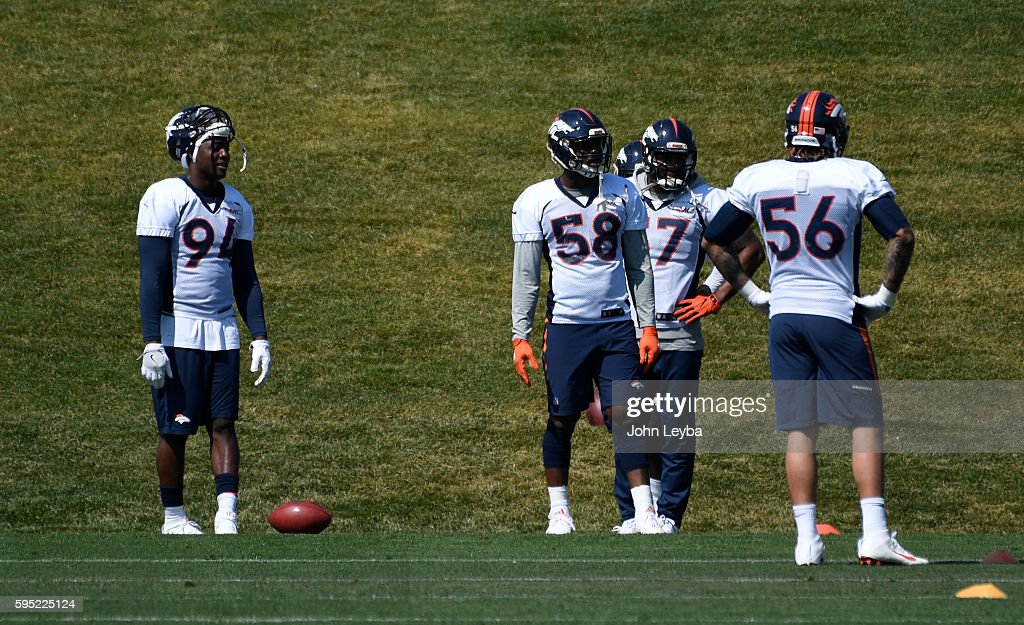 Denver Broncos outside linebacker DeMarcus Ware watches drills during practice August 26 2016 at Dove Valley