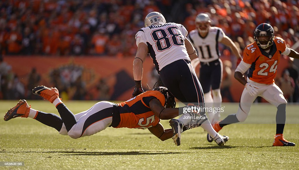 Denver Broncos outside linebacker <a gi-track='captionPersonalityLinkClicked' href=/galleries/search?phrase=Nate+Irving&family=editorial&specificpeople=4753462 ng-click='$event.stopPropagation()'>Nate Irving</a> (56) gets a hold of New England Patriots tight end Matthew Mulligan (88) during the first quarter. The Denver Broncos vs. The New England Patriots in an AFC Championship game at Sports Authority Field at Mile High in Denver on January 19, 2014.