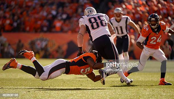Denver Broncos outside linebacker Nate Irving gets a hold of New England Patriots tight end Matthew Mulligan during the first quarter The Denver...