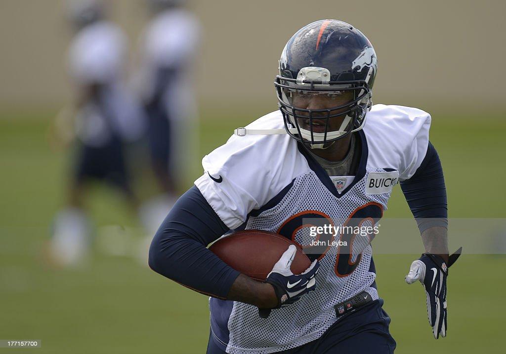 Denver Broncos outside linebacker Shaun Phillips (90) runs through drills during practice August 22, 2013 at Dove Valley