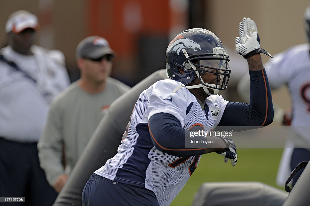 Denver Broncos outside linebacker Shaun Phillips (90) runs through drills during practice August 22, 2013 at Dove Valley