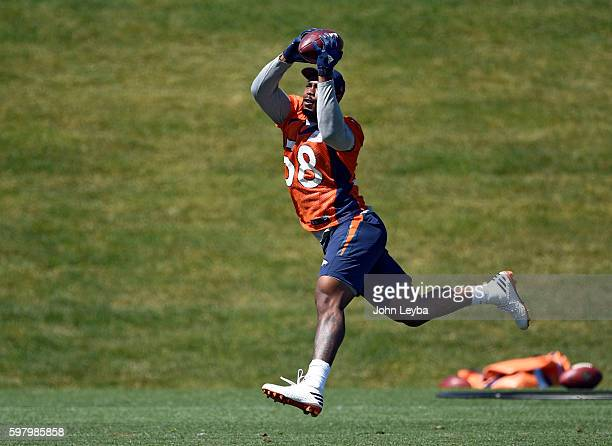 Denver Broncos outside linebacker Von Miller makes an acrobatic catch in drills during practice August 30 2016 at Dove Valley