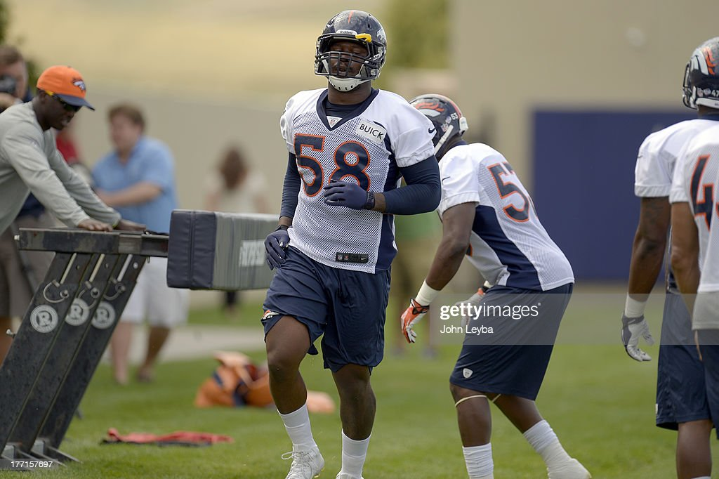 Denver Broncos outside linebacker Von Miller (58) participates in drills during practice August 22, 2013 at Dove Valley. Miller is suspended for six-games by the league after violating its drug policy.