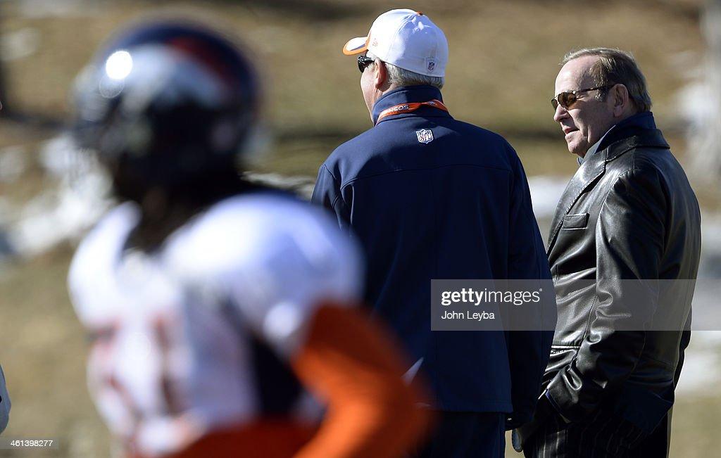 Denver Broncos owner Pat Bowlen talks with Denver Broncos head coach John Fox during practice January 8, 2014 at Dove Valley