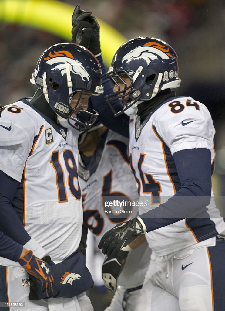 Denver Broncos player Jacob Tamme celebrates his 10-yard touchdown reception with Peyton Manning during second quarter action as the New England Patriots hosted the Denver Broncos in a regular season NFL game at Gillette Stadium on Sunday, Nov. 24, 2013.
