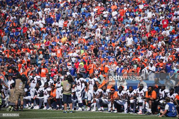 Denver Broncos players kneel during the American National Anthem before an NFL game against the Buffalo Bills on September 24 2017 at New Era Field...