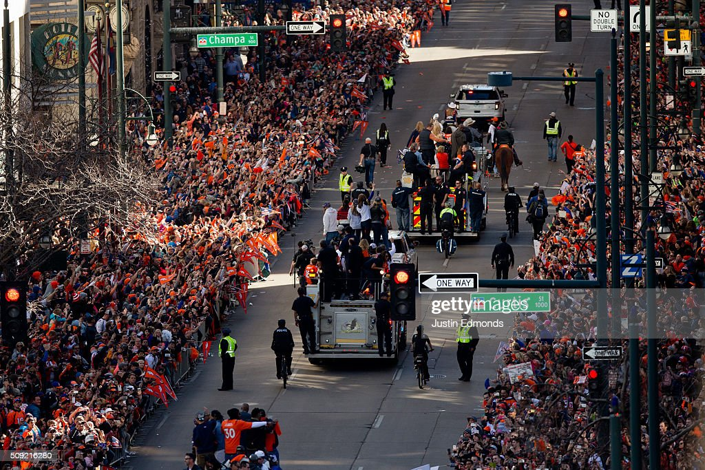 Denver Broncos players ride fire trucks as fans line the streets during a victory parade to celebrate their Super Bowl championship on February 9, 2016 in Denver, Colorado. The Broncos defeated the Carolina Panthers 24-10 in Super Bowl 50.