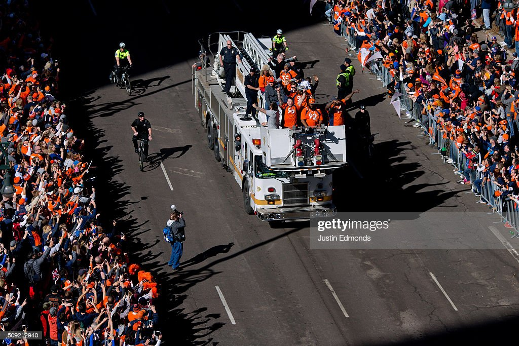 Denver Broncos players ride fire trucks during a victory parade to celebrate their Super Bowl championship on February 9, 2016 in Denver, Colorado. The Broncos defeated the Panthers 24-10 in Super Bowl 50.
