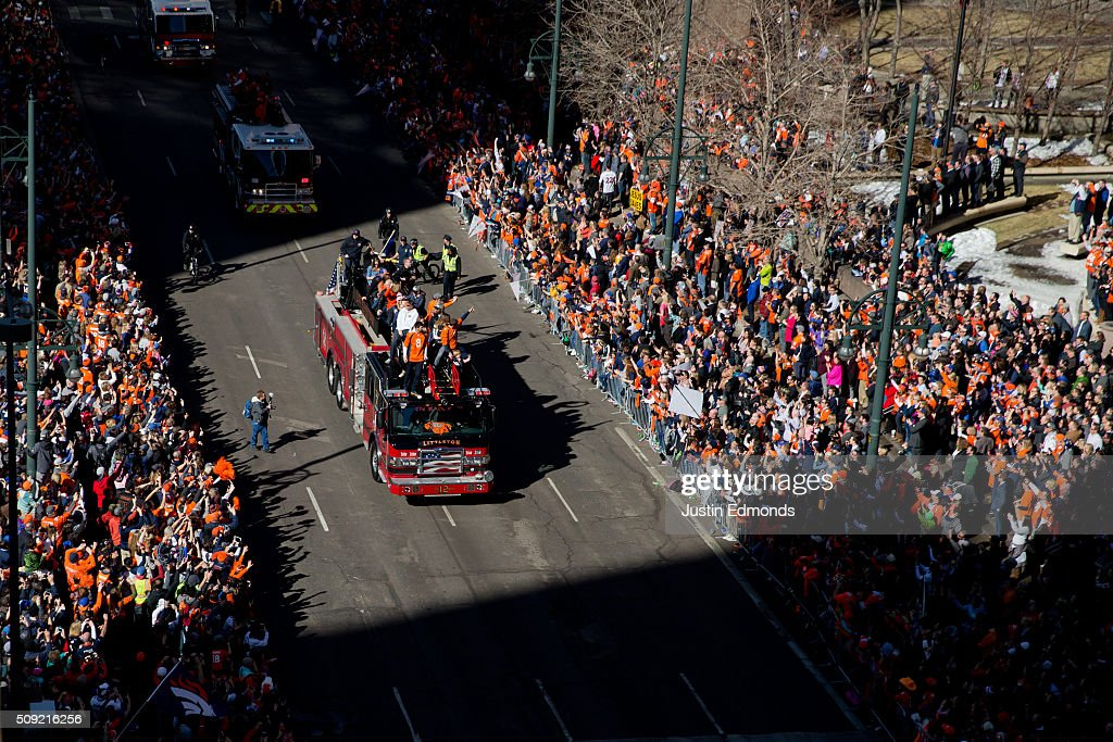Denver Broncos players ride fire trucks during a victory parade to celebrate their Super Bowl championship on February 9, 2016 in Denver, Colorado. The Broncos defeated the Carolina Panthers 24-10 in Super Bowl 50.