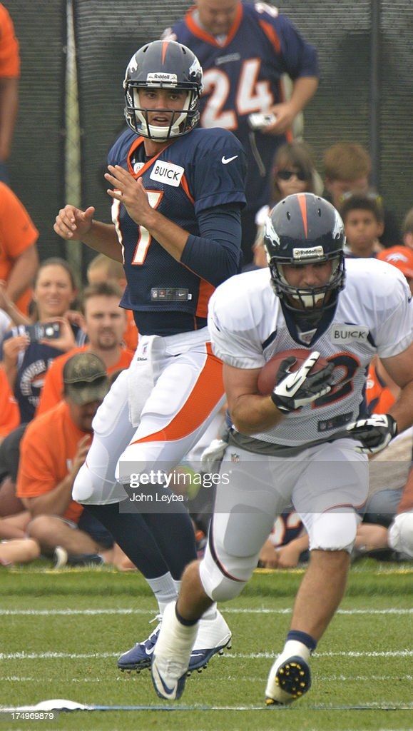 Denver Broncos QB Brock Osweiler (17) hands off to Jacob Hester (22) during training camp July 29, 2013 at Dove Valley.