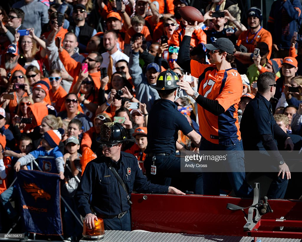 Denver Broncos QB <a gi-track='captionPersonalityLinkClicked' href=/galleries/search?phrase=Brock+Osweiler&family=editorial&specificpeople=6501030 ng-click='$event.stopPropagation()'>Brock Osweiler</a> tosses a football back to a lucky fan after he autographed it during the Super Bowl 50 celebration parade February 07, 2016.