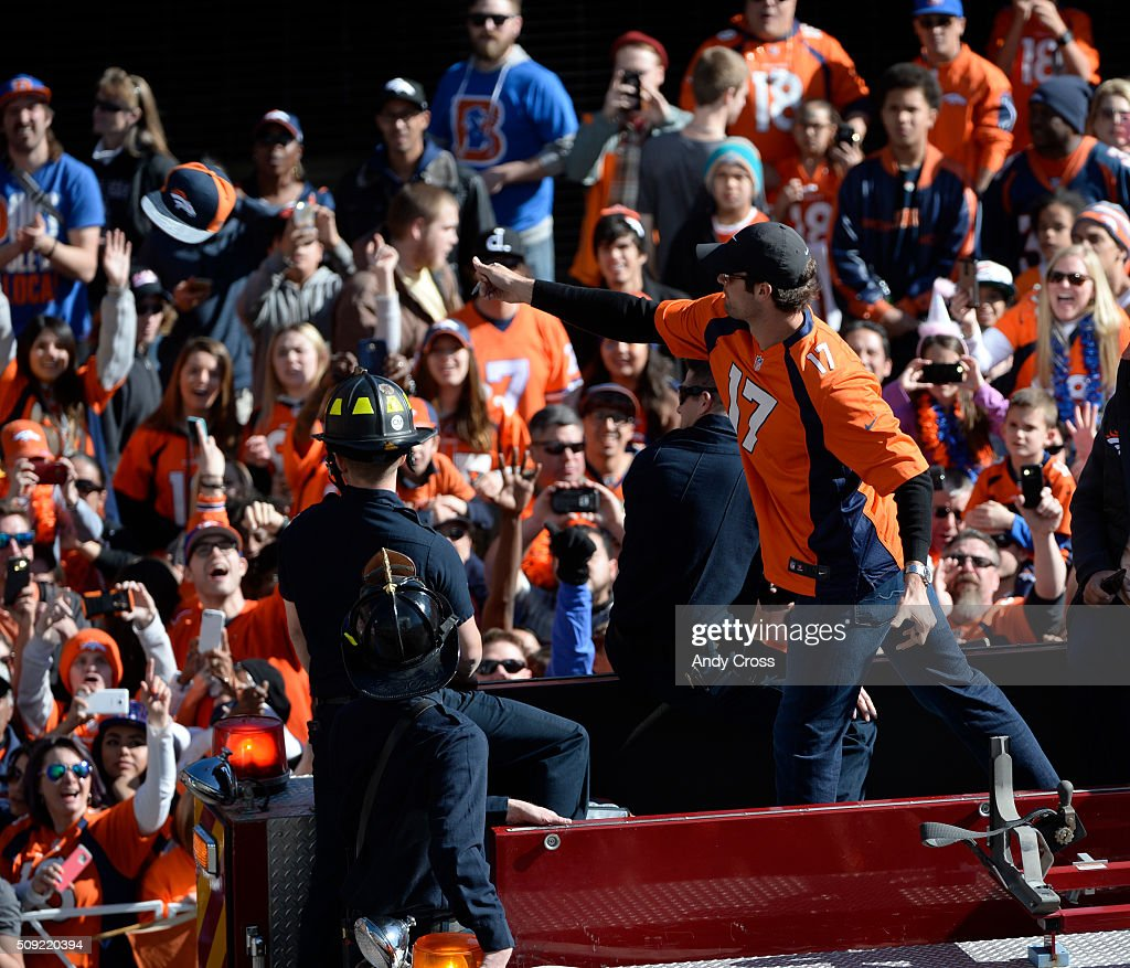 Denver Broncos QB <a gi-track='captionPersonalityLinkClicked' href=/galleries/search?phrase=Brock+Osweiler&family=editorial&specificpeople=6501030 ng-click='$event.stopPropagation()'>Brock Osweiler</a> tosses a hat back to a lucky fan after he autographed it during the Super Bowl 50 celebration parade February 07, 2016.