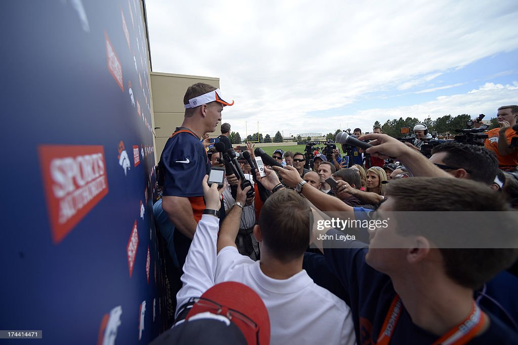 Denver Broncos QB Peyton Manning addresses the media after practice during opening day of training camp July 25, 2013 at Dove Valley.