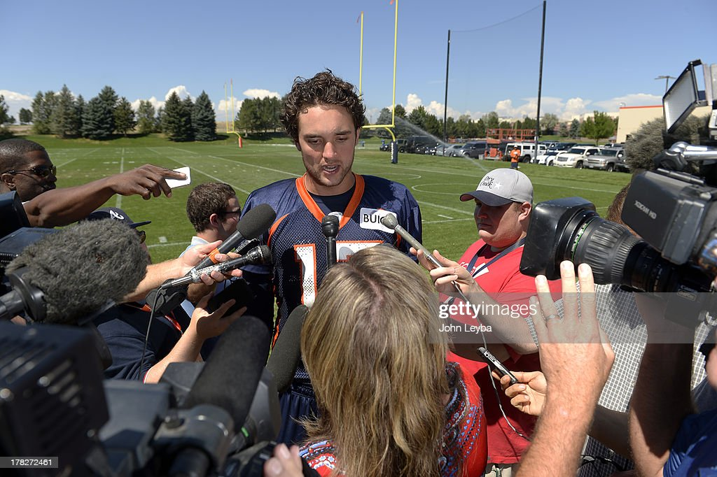 Denver Broncos quarterback Brock Osweiler (17) talks with the media after practice August 28, 2013 at Dove Valley.