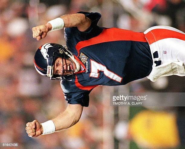 Denver Broncos quarterback John Elway celebrates a touchdown by Terrell Davis during second half action in Super Bowl XXXII in San Diego CA 25...
